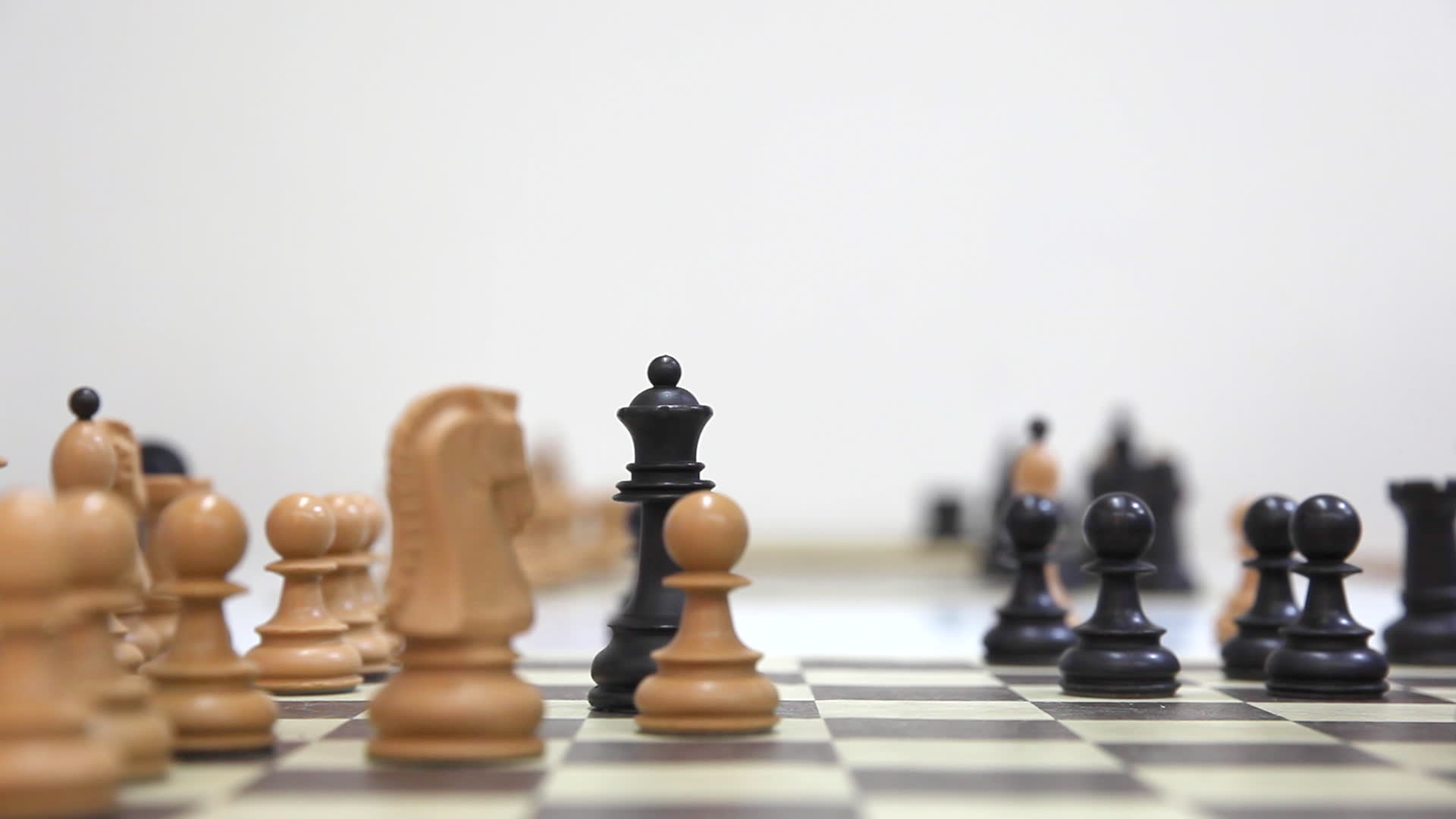 stock-footage-in-a-chess-game-on-chessboard-black-queen-take-white-queen